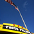 20121206140322-bus_under_flag_nm