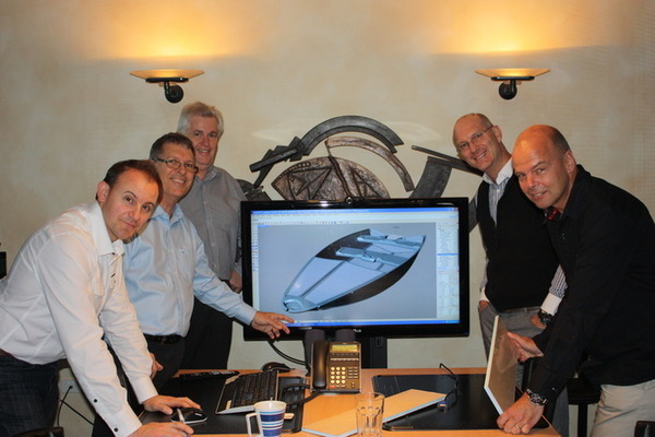 Quickboats President Deryck Graham (back right), Design + Industry team (left) and composite specialist Monsieur Eric Metrot in front on right