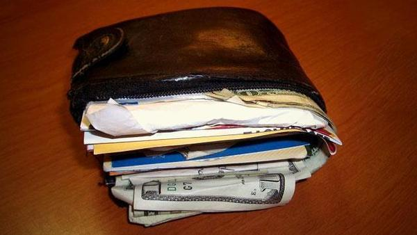 Sitting on a Fat Wallet for an extended period can cause backache