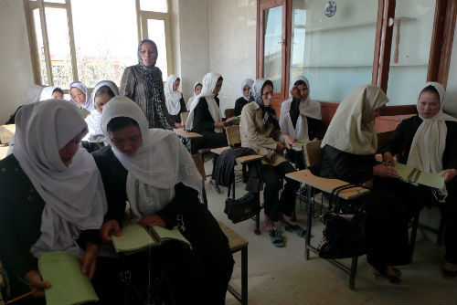 Classroom of Afghan women studying.