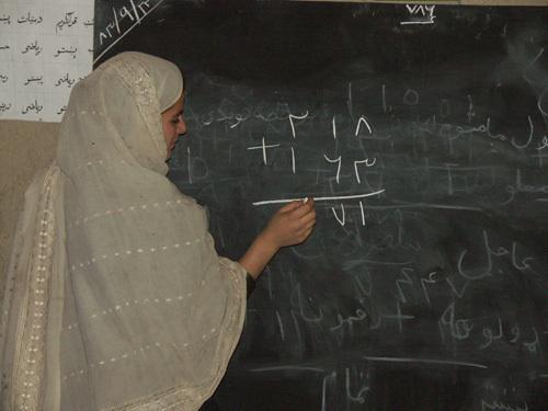 Afghan woman studies math.