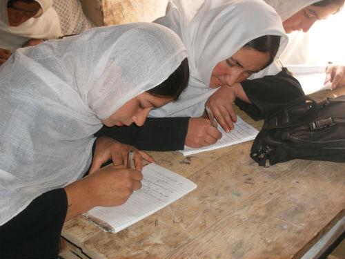 Afghan girls study hard.