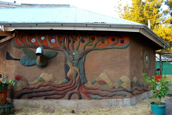Eco-construction adobe mural (with natural colors) added to the outside of the main learning space at the Gaia University Latin American hub, El Manzano Eco-village, Chile (photo taken March, 2013).