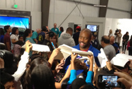 Astronaut Leland Melvin signing autographs for field trip students!