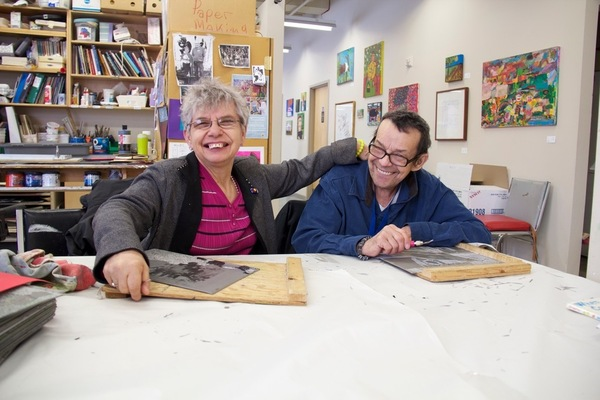 Cheryl and John making art at The Nina's studio.
