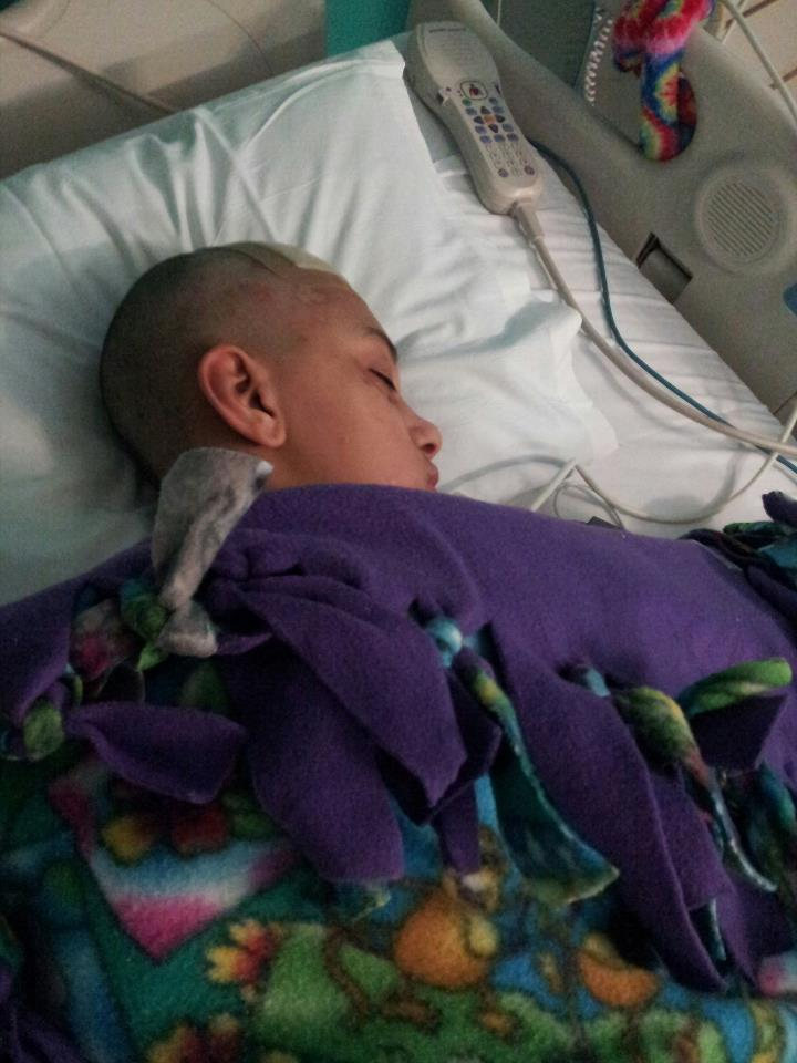 Aimee Faye asleep after surgery